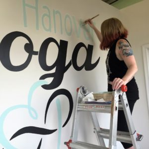 Local Yoga studio's Logo being painted by one of our Artists.